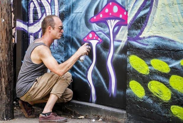 Artist Dylan Bradway paints street art in the Plaza Walls section during Plaza District Festival in the Plaza District in Oklahoma City, Okla., Saturday, Sept. 24, 2016. Photo by Chris Landsberger, The Oklahoman Archives
