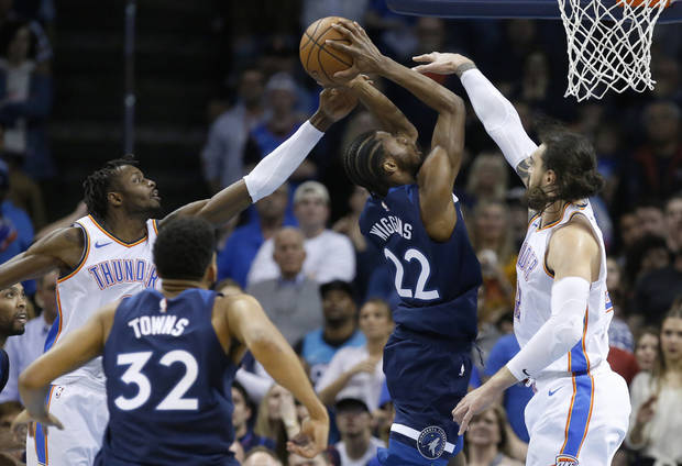 Minnesota Timberwolves forward Andrew Wiggins (22) goes up for a shot  between Oklahoma City 725412b9f