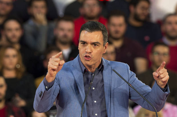 Socialists, left-wing party reach coalition deal in Spain