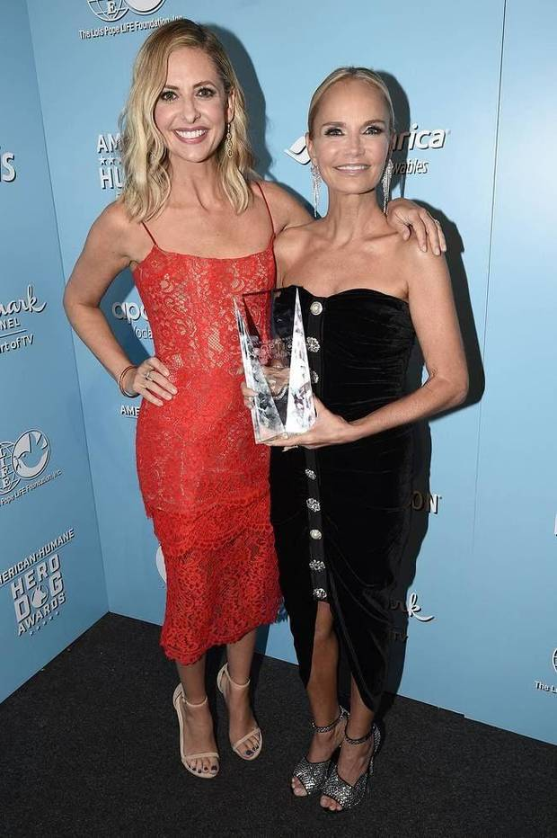 Sarah Michelle Gellar and Kristin Chenoweth, this year's Adoption Ever After Award honoree, pose at the 2019 American Humane Hero Dog Awards, which air Oct. 21 on Hallmark Channel. [Photo by Dan Steinberg/Invision for American Humane/AP Images]
