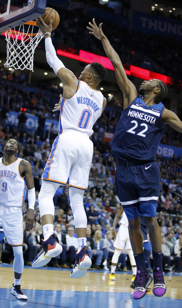 Russell Westbrook goes up for a basket defended by Minnesota's Andrew Wiggins in a game last January. (Photo by Sarah Phipps)