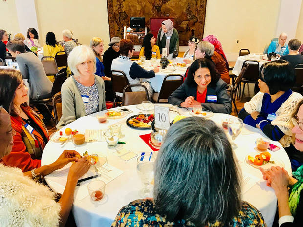 A group of women enjoy a conversation and tea at the third annual Diversi-Tea on Jan. 21 at St. Paul's Episcopal Cathedral in downtown Oklahoman City. [Photo by Carla Hinton, The Oklahoman]