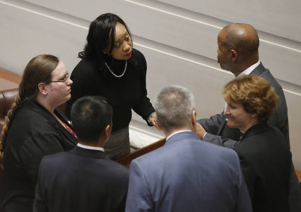 Oklahoma state Sen. Anastasia Pittman, D-Oklahoma City, talks with colleagues on the Senate floor before a vote on a package of tax hikes to fund teacher pay raises in Oklahoma City, Wednesday, March 28, 2018. (AP Photo/Sue Ogrocki)