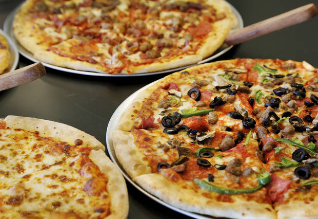 Peter Piper Pizza is returning to the Oklahoma City market and will unveil its first new prototype store at 4701 SE 15th  in Del City.   A variety of pizzas are included in the lunch buffet offering. Photo by Jim Beckel, The Oklahoman