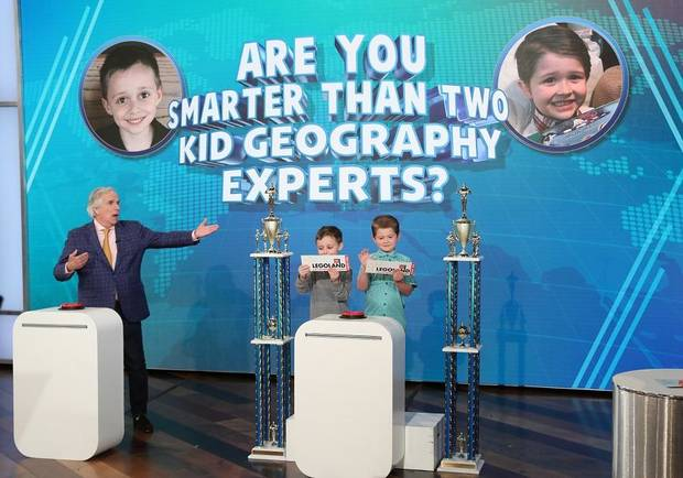 "Henry Winkler, left, and kid geography experts 7-year-old Nate Seltzer from Stratford, Connecticut, and 6-year-old Landon Gregory from Collinsville, appear on ""The Ellen DeGeneres Show."" [Photo by Michael Rozman/Warner Bros.]"