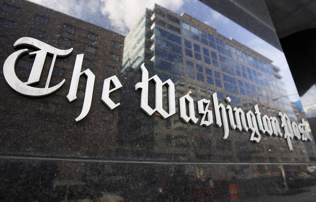 FILE -  In this Feb. 27, 2008, file photo, The Washington Post sign is seen on its building in Washington. On Monday, Aug. 5, 2013, the Washington Post announced the paper has been sold to Amazon founder Jeff Bezos. (AP Photo/Manuel Balce Ceneta, File) ORG XMIT: WX121