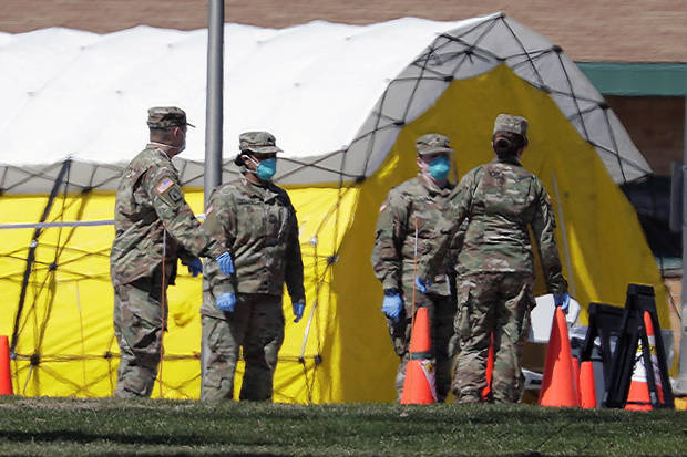 The Latest: Pentagon: Active duty infections topped 1,000