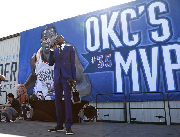 Oklahoma City Thunder's Kevin Durant speaks during a rally of fans following a news conference where he was announced as the winner of the 2013-14 Kia NBA Basketball Most Value Player Award in Oklahoma City, Tuesday, May 6, 2014. (AP Photo/Sue Ogrocki)