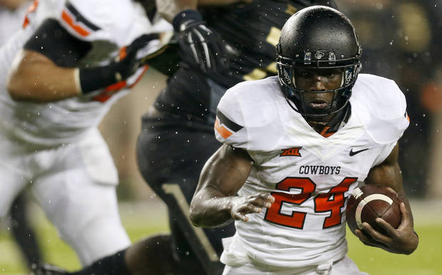 Former Oklahoma State running back Tyreek Hill (24) carries the ball during a college football game between the Oklahoma State University Cowboys (OSU) and the Baylor Bears at McLane Stadium in Waco, Texas, Saturday, Nov. 22, 2014. Baylor won, 49-28. Photo by Nate Billings, The Oklahoman