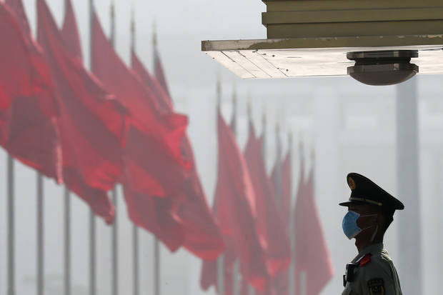 China to boost defense spending by lowest rate in years