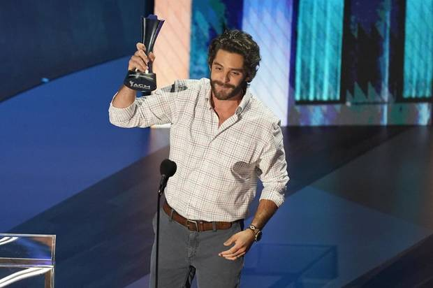 Thomas Rhett accepts the entertainer of the year award in a tie with Carrie Underwood during the 55th annual Academy of Country Music Awards at the Grand Ole Opry House on Wednesday, Sept. 16, 2020, in Nashville, Tenn. [AP Photo/Mark Humphrey]