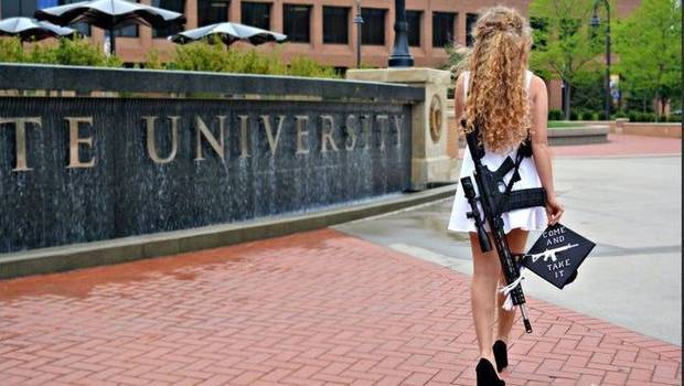 Kent State 'gun girl' who walked campus with AR confronted by protesters at Ohio University