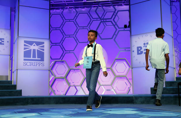 Saisurya Lakkimsetti, 9, from Tulsa, Okla., walks to the microphone during the 2nd Round of the Scripps National Spelling Bee, Tuesday, May 29, 2018, in Oxon Hill, Md. (AP Photo/Alex Brandon)