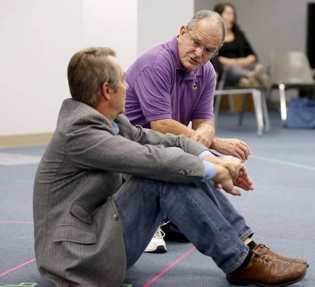 "Terry Veal, as Judge Taylor, talks with Eric Starkey, as Atticus Finch, during a rehearsal for Oklahoma Children's Theatre and TheatreOCU's co-production of ""To Kill a Mockingbird"" at Oklahoma City University, Wednesday, Oct. 9, 2019. [Bryan Terry/The Oklahoman]"
