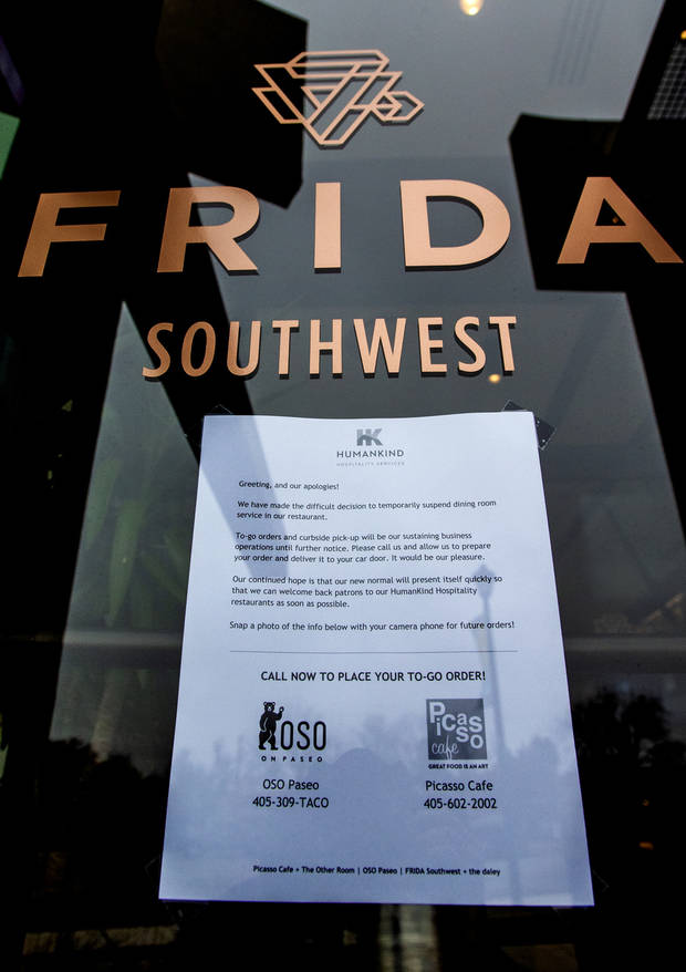 The sign letting customers know that Frida Southwest restaurant in Oklahoma City, Okla. made the decision to close in effort to prevent the spread of the coronavirus on Tuesday, March 17, 2020. The restaurant [Chris Landsberger/The Oklahoman]