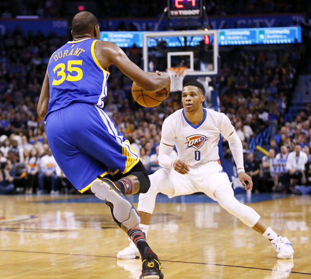 Oklahoma City's Russell Westbrook (0) defends Golden State's Kevin Durant (35) during an NBA basketball game between the Oklahoma City Thunder and the Golden State Warriors at Chesapeake Energy Arena in Oklahoma City, Saturday, Feb. 11, 2017. Photo by Nate Billings, The Oklahoman