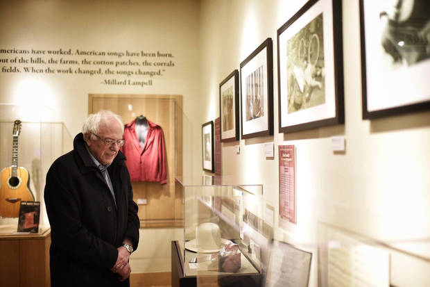Bernie Sanders observing the Woody Guthrie collection and archives at the Woody Guthrie Center in downtown Tulsa. [Photo via berniesanders.com]