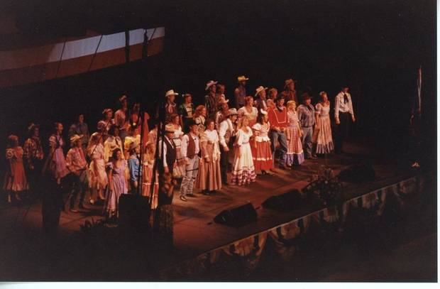 "People appear on stage during the July 22, 1995, ""Healing in the Heartland Appreciation Celebration"" at State Fair Arena. The concert was intended to bring people together and celebrate the state's cohesion after the Oklahoma City bombing. [Jim Spearman Collection/Oklahoma City National Memorial & Museum]"