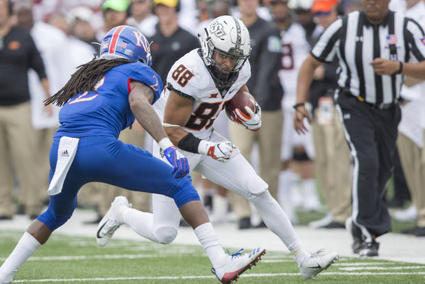 Saturday saw quite the uniform matchup with Oklahoma State's all-whites and Kansas' all-blues. [PHOTO BY BRUCE WATERFIELD, Courtesy OSU Athletics]
