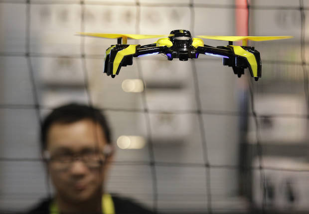 The Phoenix drone flies at the TDR booth during CES International, Thursday, Jan. 5, 2017, in Las Vegas. (AP Photo/John Locher)