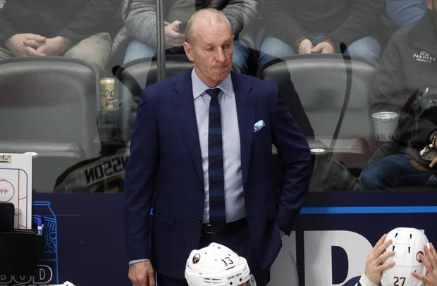 The Latest: Coach 'still hanging on' to NHL season resuming