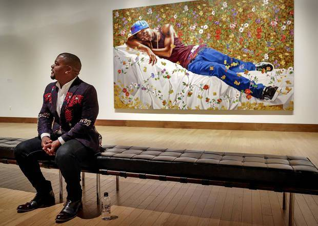 "Artist Kehinde Wiley speaks recently about his art before the opening of his show ""A New Republic"" at the Oklahoma City Museum of Art in Oklahoma City. Behind his is his heroic-size painting ""Morpheus."" Photo by Chris Landsberger, The Oklahoman"