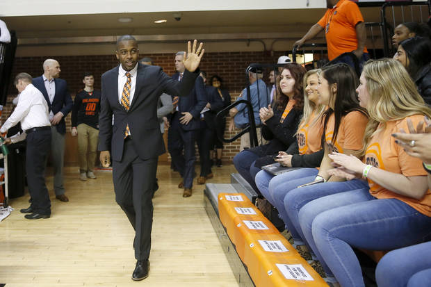 Mike Boynton waves to fans before Wednesday's game at Gallagher-Iba Arena. [Bryan Terry/The Oklahoman]
