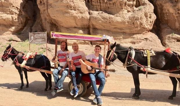 From left, Brent Saulsbury, Kyle Dillingham and Peter Markes of the Oklahoma band Kyle Dillingham & Horseshoe Road take a donkey taxi at Yellow River Stone Forest. [Photo by Ginnette Dillingham]