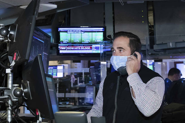Asian shares rise after Dow crests 30,000 on vaccine hopes
