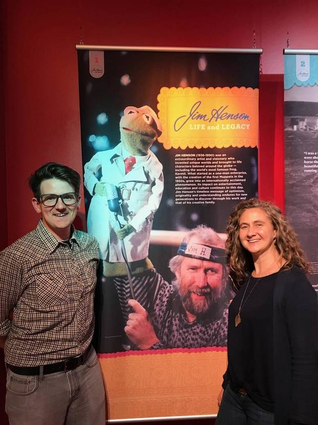 "Lucas Ross, community outreach and promotions coordinator. for the American Banjo Museum, and Heather Henson, daughter of the late Jim Henson, stand in the exhibit ""Jim Henson - Life and Legacy"" at the American Banjo Museum. [Photo provided]"