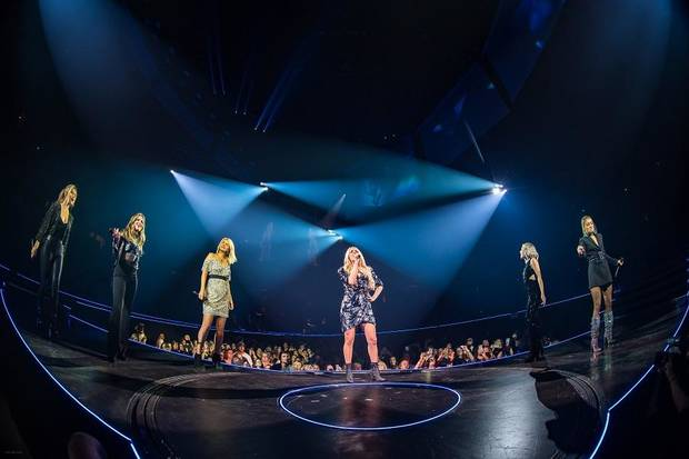 "Carrie Underwood, center, performs the ""Women of Country Medley,"" with her supporting acts Maddie & Tae, right, and Runaway June in Birmingham, Alabama. [Photo by Ralph Larmann]"