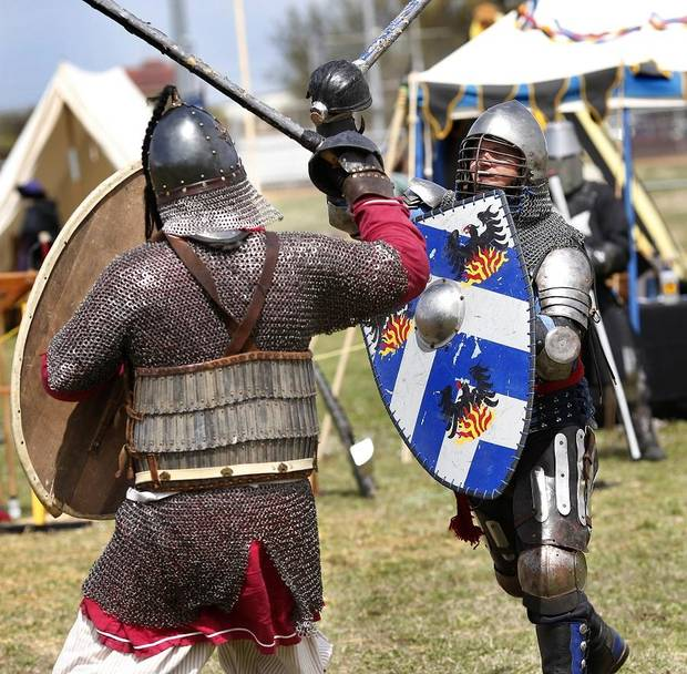 Members of the Society for Creative Anachronism stage armored combat sessions that depict chivalric fighting styles employed by knights at the 2019 Medieval Fair of Norman in Reaves Park on Friday, April 5, 2019. [The Oklahoman Archives]