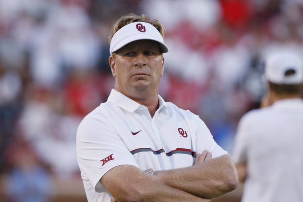 FILE - In this Sept. 17, 2016, file photo, Oklahoma defensive coordinator Mike Stoops watches his team before an NCAA college football game against Ohio State, in Norman, Okla. Oklahoma has fired defensive coordinator Mike Stoops after the Sooners struggled to stop Texas in their first loss of the season. The Sooners said Monday, Oct. 8, 2018, that Ruffin McNeill, the assistant head coach and defensive tackles coach, will be the defensive coordinator for the rest of the season. (AP Photo/Sue Ogrocki, File)