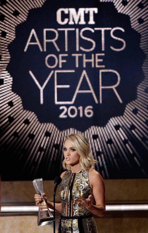 459bd1b5734f Carrie Underwood speaks after accepting her award during the CMT Artists of  the Year awards show
