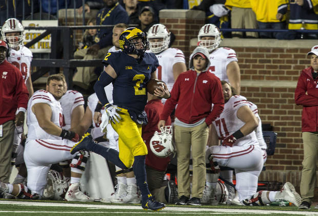 College Football Notebook: Patterson learning on the run for Michigan