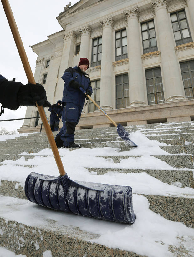 Nathan Warden, part of the Capitol renovation crew, helps clear snow from the east steps of the State Capitol building in Oklahoma City, Okla. Friday, Jan. 6, 2017.  Photo by Paul Hellstern, The Oklahoman