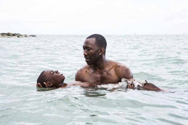 "Alex Hibbert, left, and Mahershala Ali appear in a scene from the film ""Moonlight."" A24 photo"