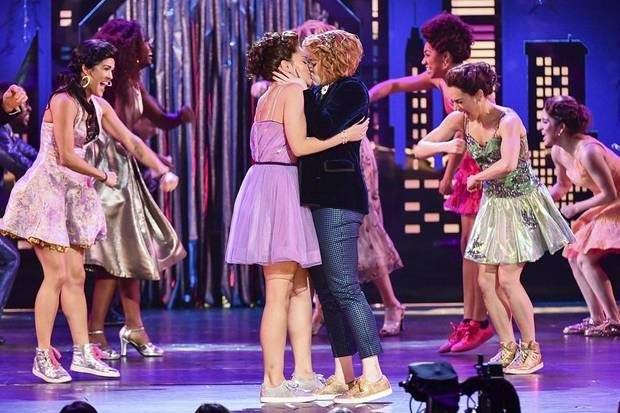 "Isabelle McCalla, front left, and Caitlin Kinnunen, of the cast of ""The Prom,"" kiss as they perform at the 73rd annual Tony Awards at Radio City Music Hall on Sunday, June 9, 2019, in New York. [Photo by Charles Sykes/Invision/AP]"