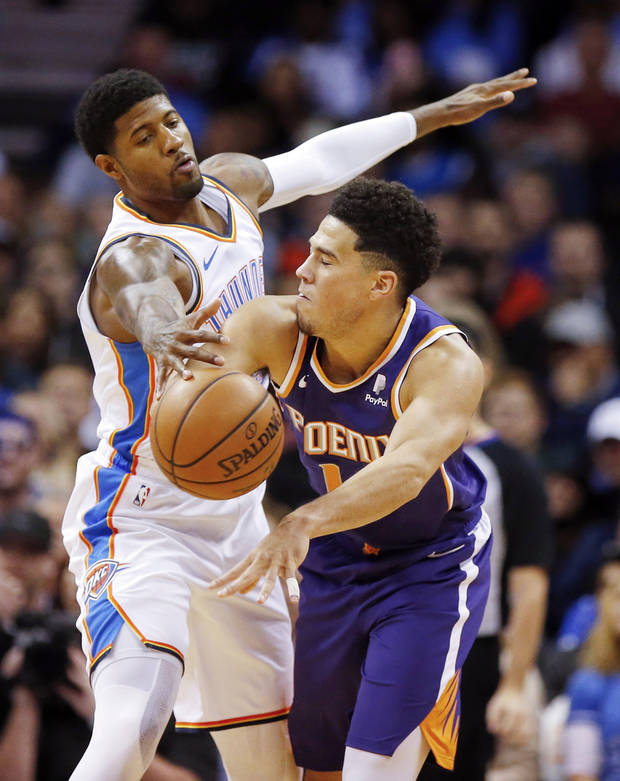 Oklahoma City s Paul George (13) defends Phoenix s Devin Booker (1) during  an 820156155