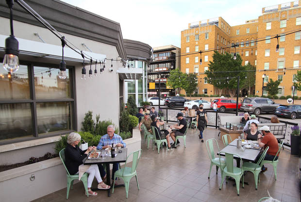 Stella Modern Italian has started limited service back up, keeping dine in customers on the patio, Friday, May 1, 2020. [Doug Hoke/The Oklahoman]