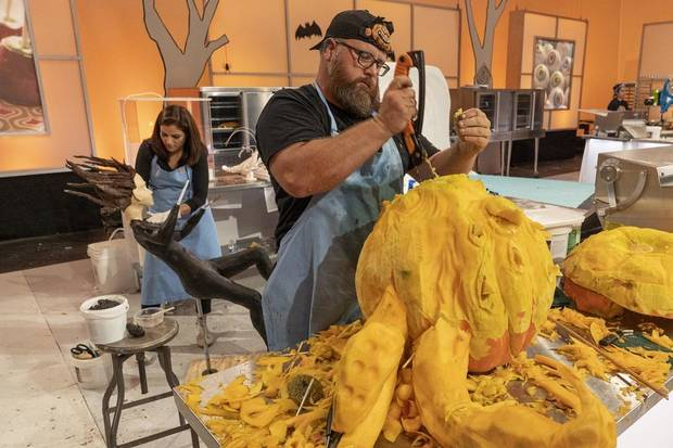 "Team Mummies Rejects Pumpkin Carver Daniel Miller, who hails from Wilson, Oklahoma, sculpts a giant octopus head during Episode 4 of ""Halloween Wars"" Season 10. [Food Network photo]"