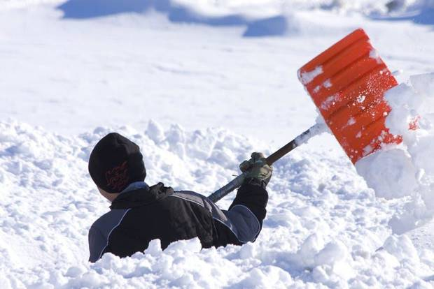 Why does shoveling snow increase risk of heart attack?