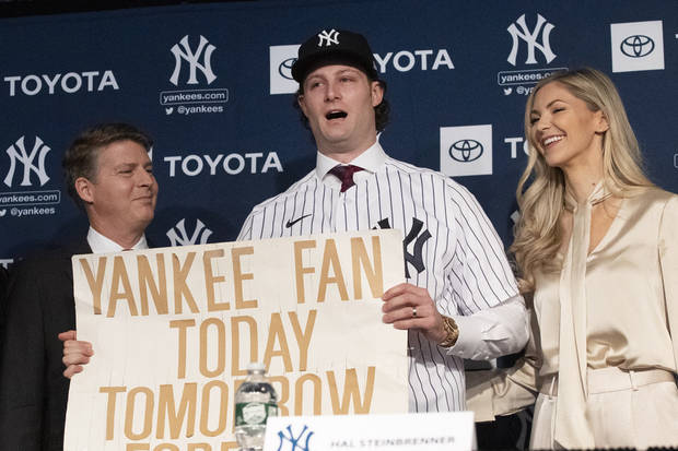 Future sign: Cole arrives with old placard of Yankees fealty