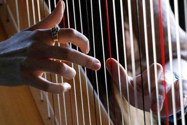 Yiskah performs on the harp during Norman Music Festival 2019 on April 27, 2019 in Norman, Okla. [Steve Sisney/For The Oklahoman]