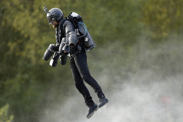 Richard Browning sets the Guinness World Record for 'the fastest speed in a body-controlled jet engine power suit', at Lagoona Park in Reading, England, Thursday, Nov. 9, 2017. A British inventor billed as a real-life version of the superhero Iron Man has hit the fastest speed in a body-controlled jet engine power suit at 32 mph (51 kph) to set a new Guinness world record. The record keeper announced Tuesday's feat on Thursday as part of its annual Guinness World Records day. (Tim Ireland/PA via AP)