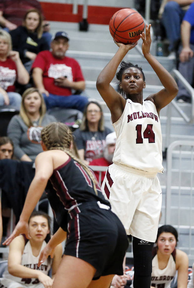 Muldrow's Taylen Collins (14) shoots near Holland Hall's Gabby Gregory (12) during a Class 4A girls basketball quarterfinal game between Holland Hall and Muldrow in the state tournament at Mustang High School in Mustang, Okla., Thursday, March 7, 2019. Photo by Nate Billings, The Oklahoman
