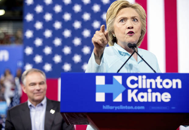 Democratic presidential candidate Hillary Clinton accompanied by Sen. Tim Kaine, D-Va., speaks at a rally at Florida International University Panther Arena in Miami, Saturday, July 23, 2016. Clinton has chosen Kaine to be her running mate. (AP Photo/Andrew Harnik)