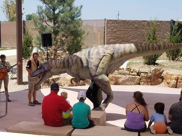 "Visitors watch the ""T-Rex Feeding Frenzy"" show at the outdoor amphitheater at Field Station: Dinosaurs in Derby, Kansas. [Photo by Brandy McDonnell, The Oklahoman]"