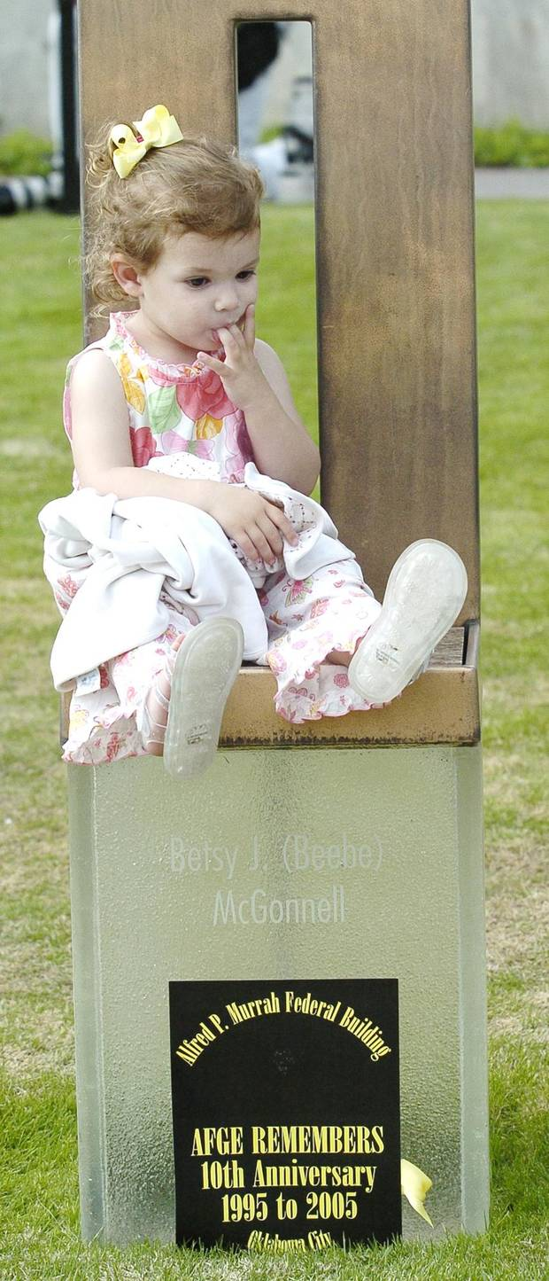 Adelaine Paticia Strunk, 2, sits on the memorial chair of Betsy J. McGonnell, which was next to the chair of her grandmother's memorial chair, Patricia Nix, at the Oklahoma City National Memorial 10th Anniversary ceremony, Tuesday, April 19, 2005, honoring those who died and those who survived in the April 19, 1995 bombing of the Alfred P. Murrah Federal Building, in Oklahoma City. By Jim Beckel/The Oklahoman.