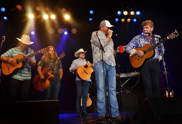 From left, Scotty Emerick, Jamey Johnson, Paul Overstreet, Toby Keith and Mac McAnally perform in concert together June at the 15th Annual Toby Keith & Friends Golf Classic in Norman. [Photo provided]